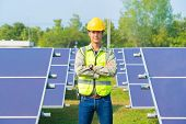 Portrait Of Engineer Man Or Worker, People, With Solar Panels Or Solar Cells On The Roof In Farm. Po poster