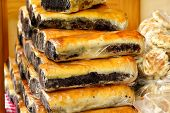 Domestic Strudels With Flavor Of Poppy Seeds And Walnuts For Sale At Christmas Market Place Outdoors poster
