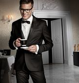 pic of mug shot  - Handsome man with cup of coffee - JPG