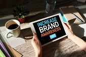 Increase Brand Awareness Text On Screen. Advertising And Marketing Concept. poster