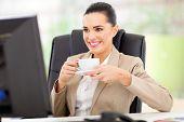 caucasian business woman having tea in front of computer