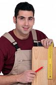 Tradesman using a try square