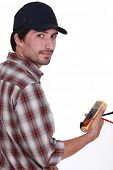 Tradesman holding a multimeter