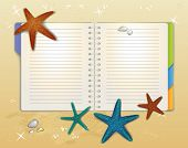 Open Spiral Notebook on a Sandy Beach, with colorful starfishes and shiny pebbles