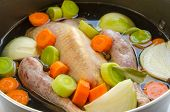 stock photo of guinea fowl  - Organic raw guinea fowl prepared to be cooked as broth - JPG