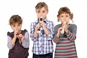 three little girls playing flute