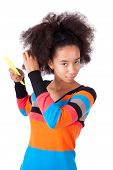 Black African American Teenage Girl Combing Her Afro Hair