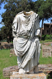 image of beheaded  - Beheaded statue of a roman senator in Ostia Antica the old harbour of Rome, Italy ** Note: Shallow depth of field - JPG