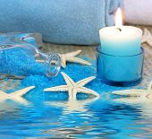 Blue spa with candle and seastar