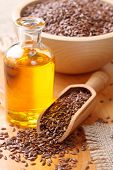 stock photo of flaxseeds  - Linseed oil and flax seeds - JPG