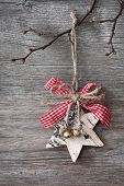 stock photo of timber  - Christmas decoration hanging over wooden background - JPG