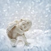 stock photo of cherub  - Angel statue on silver background - JPG