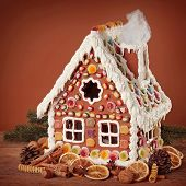 Homemade gingerbread house on brown background