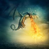 stock photo of fire-breathing  - Flying fantasy dragon at night - JPG
