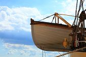 Lifeboat On A Old Ship Blue Sky Background