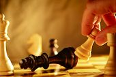Постер, плакат: Man Making A Move In A Game Of Chess