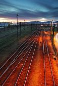 Railroad Track At Night With Colorful Sky