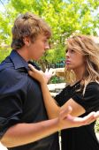 foto of cheater  - young woman angry at her lying boyfriend - JPG