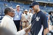 BRONX, NY-JUNE 1; Supercentenarian Bernardo LaPallo, who is 111 years old, shakes hands with New Yor