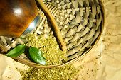 stock photo of calabash  - Calabash and bombilla with yerba mate on old paper background - JPG