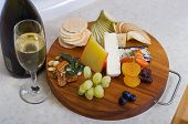 pic of fruit platter  - Overhead view of a cheese and fruit platter with sparkling wine - JPG