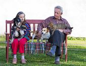 Girl and her grandfather with pets