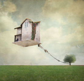 foto of house representatives  - Artistic image representing an house floating in the air tied to a rope to the tree in a surreal vintage background - JPG