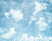 image of puffy  - Grunge blue sky background with space for text - JPG