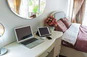 Interior of a modern bed room with laptop computer