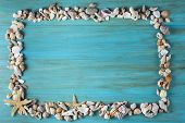 stock photo of carapace  - Summer holidays background in blue with fishing net ans seashells and a space for advertising - JPG
