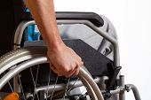 stock photo of disable  - Disabled young man using his new wheelchair - JPG