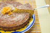 stock photo of calabash  - Homemade coconut and pumpkin cake on a yellow tablecloth - JPG