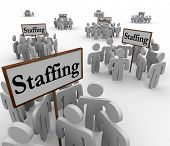 Staffing word signs groups workers employes job hiring foto.
