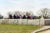 JEDWABNE - APRIL 6: Peoples at the monument of Jewish massacre in Jedwabne, Poland on April 6, 2014.