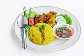 Yellow Rice With Fried Chicken On Dish.