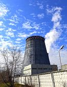 image of chp  - Large factory chimneys on blue sky background - JPG