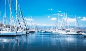 Sailboat harbor, many beautiful moored sail yachts in the sea port, modern water transport, summertime vacation, luxury lifestyle and wealth concept