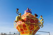 Russia, Samara - March 2, 2014: Shrovetide In Russia. Big Improvised Samovar Over Blue Sky. Maslenit