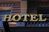 Illuminated Yellow Hotel Signboard