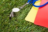 Whistle With Red And Yellow Card On The Field