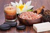 Spa Products With Illuminated Candles On Wooden Table