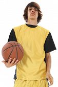 Teen Boy Holding Basket Ball Over White