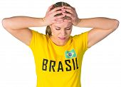Disappointed football fan in brasil tshirt on white background