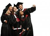 foto of mantle  - Multi ethnic group of graduated young students taking selfie - JPG