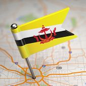 Brunei Small Flag on a Map Background.