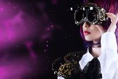 stock photo of post-apocalypse  - Girl in a stylized steampunk costume posing on a black background - JPG