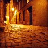 Narrow street in european city at night.