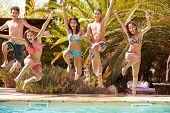 picture of teenagers  - Group Of Teenage Friends Jumping Into Swimming Pool - JPG