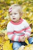 Baby Girl With Autumn Leaves