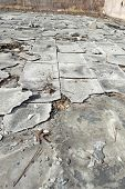 image of cinder block  - Tile floor out in the element after the motel burned down - JPG